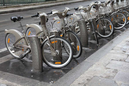 shared sharing: PARIS - JULY 20: Bicycle sharing station on July 20, 2011 in Paris, France. With 20,600 bicycles, Paris sharing system is largest in Europe.