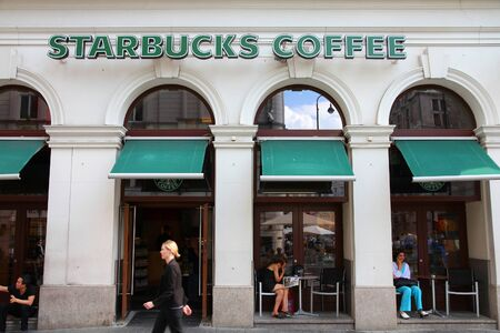 famous industries: VIENNA - SEPTEMBER 5: Starbucks Coffee coffeehouse on September 5, 2011 in Vienna. Starbucks is the largest coffeehouse company in the world, with 19,435 stores in 58 countries (2012).