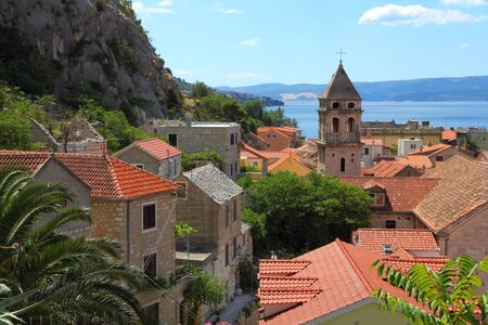 Далмация: Croatia - Omis in Dalmatia. Old town view.