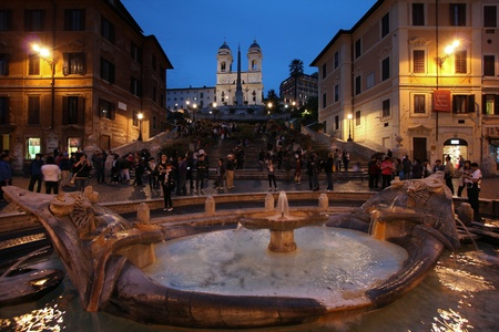 ROME - MAY 10: Tourists strolling on May 10, 2010 in Rome, Italy. Piazza di Spagna with its fountain and Spanish Steps is one of the most iconic city squares in the world and one of Italy's top tourism destinations. Stock Photo - 12779180