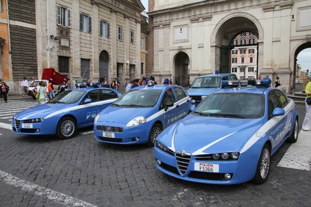 romeo: ROME - MAY 12: Italian Police vehicles on May 12, 2010 in Rome. Italian Police is known for using only Italian-made vehicles (Fiat Grande Punto and Alfa Romeo 159 pictured).