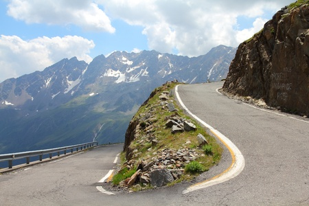 mountain pass: Italy, Stelvio National Park. Famous road to Gavia Pass in Ortler Alps. Alpine landscape.