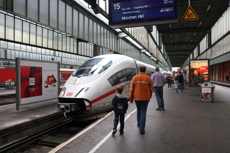 STUTTGART, GERMANY - JULY 24: Intercity Express (ICE) train of Deutsche Bahn on July 24, 2010 in Stuttgart, Germany. DB is a profitable national railway company with 2.3bn EUR income for 2011. Stock Photo - 13022726