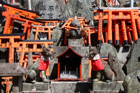shinto: Fushimi Inari Taisha shrine in Kyoto prefecture of Japan. Famous shinto shrine. Statues of fox messengers (kitsune). Editorial