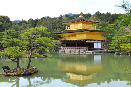 pavillion: Kyoto, Japan - Golden Pavillion shariden at famous Kinkakuji (Kinkaku-ji) Temple. Buddhist zen temple of Rinzai school.