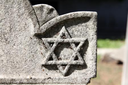 jewish star: Star of David - Jewish symbol on an old Hebrew grave in Campo Verano cemetery, Rome. Stock Photo