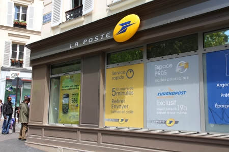 PARIS - JULY 24: La Poste branch on July 24, 2011 in Paris, France. La Poste is France's leading employer with a total workforce of 300,000. Founded in 1576, it is among oldest postal services.