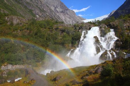 Norway, Jostedalsbreen National Park. Famous waterfall originating from Briksdalsbreen glacier in Briksdalen valley. photo