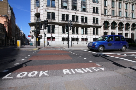 London, United Kingdom - street view with look right message and a taxi cab photo