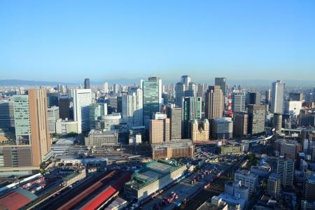 osaka: Osaka, Japan - skyline of famous city in the region Kansai. Modern metropolis. Stock Photo