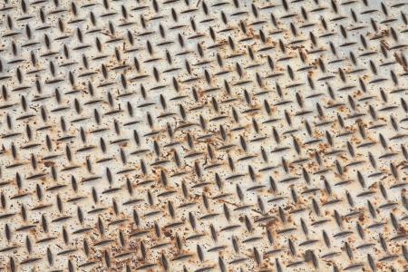 Rusty diamont plate steel floor. Metal background. Stock Photo - 14024631