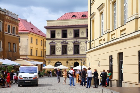 LUBLIN, POLAND - AUGUST 10: Tourists visit the Old Town on August 10, 2011 in Lublin, Poland. According to Tourism Institute, almost 2 million foreign tourists visited Lublin in 2010.