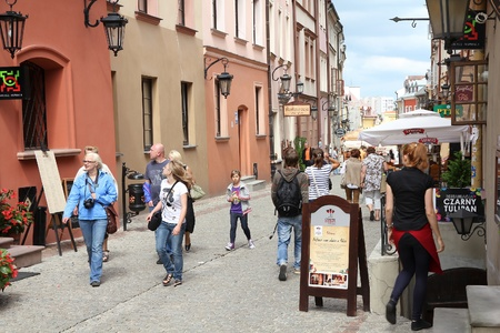 LUBLIN, POLAND - AUGUST 10: Tourists visit the Old Town on August 10, 2011 in Lublin, Poland. According to Tourism Institute, almost 2 million foreign tourists visited Lublin in 2010. Stock Photo - 14141724