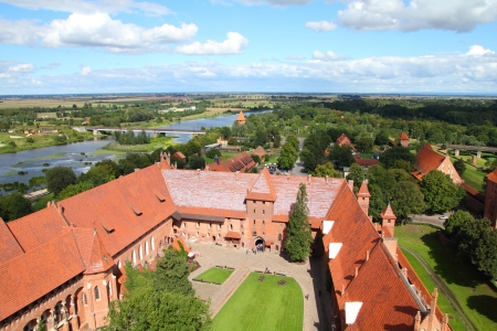 Malbork castle in Pomerania region of Poland. Teutonic Knights fortress also known as Marienburg - aerial view.