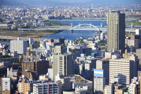 Osaka, Japan - skyline of famous city in the region Kansai. Modern metropolis with Yodo River. photo