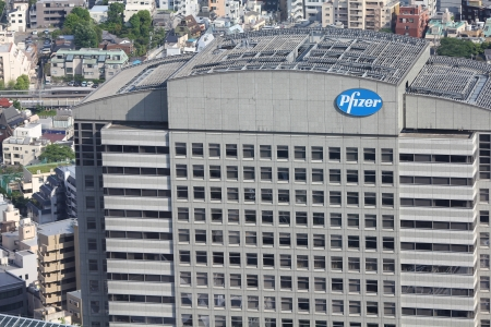 exists: TOKYO - MAY 11: Pfizer building on May 11, 2012 in Tokyo. Pfizer is one of largest pharmaceutical companies worldwide with tremendous revenue $67.4 bn USD for 2011. It exists since 1849. Editorial