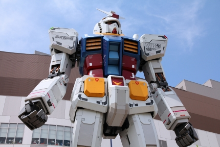 mecha: TOKYO - MAY 11: Gundam robot replica on May 11, 2012 in Tokyo. The sculpture is 18m tall and is the tallest replica of famous anime franchise robot, Gundam.