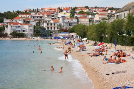 vacationers: PRIMOSTEN, CROATIA - JUNE 24: Vacationers enjoy the beach on June 24, 2011 in Primosten, Croatia. In 2011 11.2 million tourists visited Croatia, most of them in summer. Editorial