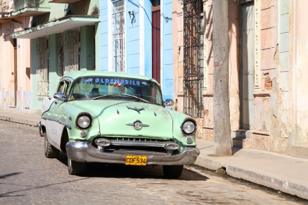 resulted: CAMAGUEY, CUBA - FEBRUARY 17: Classic American car on February 17, 2011 in Camaguey, Cuba. Recent law change allows the Cubans to trade cars again. Old law resulted in very old cars in Cuba.