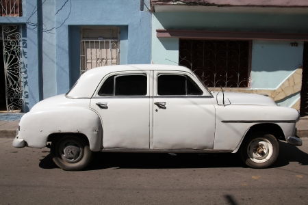 resulted: SANTA CLARA, CUBA - FEBRUARY 21: Classic American car on February 21, 2011 in Santa Clara, Cuba. Recent law change allows the Cubans to trade cars again. Old law resulted in very old cars in Cuba.
