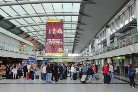 DORTMUND, GERMANY - JULY 17: People wait at the airport on July 17, 2012 in Dortmund, Germany. It exists since 1925 and had 1.7 million passengers in 2010. Editorial