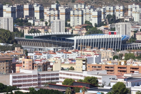 Malaga in Andalusia, Spain. Cityscape with the stadium. photo