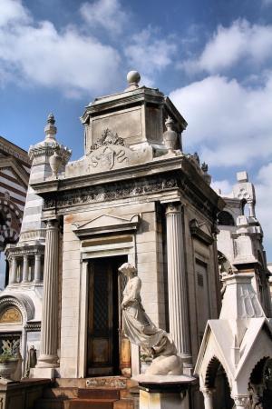 monumental cemetery: Milan, Italy. Famous landmark - old grave at the Monumental Cemetery (Cimitero Monumentale). Religious art. Stock Photo