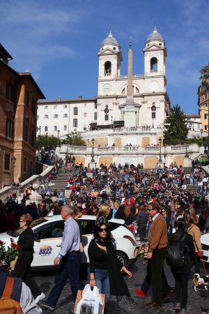 ROME - April 10: Tourists sit on Spanish Steps on April 10, 2012 in Rome. According to Euromonitor, Rome is the 3rd most visited city in Europe (5.5m international tourist arrivals 2009) Stock Photo - 14515395
