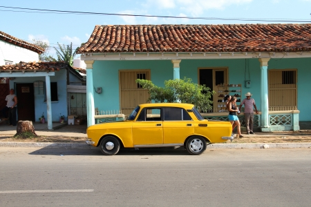 russian car: VINALES, CUBA - JANUARY 31: People walk past Russian car on January 31, 2011 in Vinales, Cuba. Recent change in law allows the Cubans to trade cars again. Most cars in Cuba are very old because of the old law. Editorial