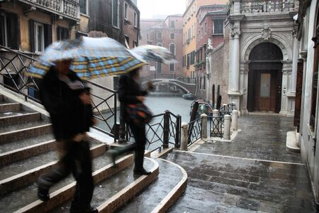 Venice, Italy - old town in heavy rain. Rainy autumn view. photo