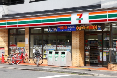KYOTO, JAPAN - APRIL 19: 7-Eleven convenience store on April 19, 2012 in Kyoto, Japan. 7-Eleven is world's largest operator, franchisor and licensor of convenience stores, with more than 46,000 shops. Stock Photo - 14681654