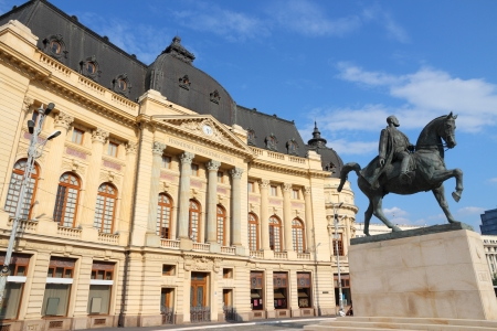 Bucharest, capital city of Romania. Central University Library and statue of king Carol I of Romania. Stock Photo