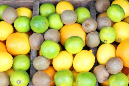 Mixed fruit in a wooden box at a farmer's market Stock Photo - 15029554