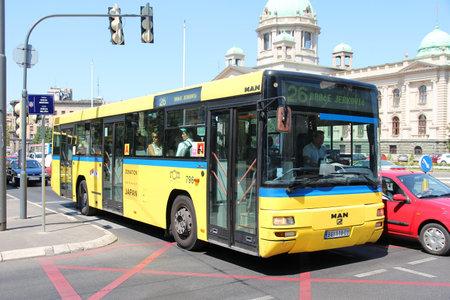 serbian: BELGRADE, SERBIA - AUGUST 15: Commuters ride a bus on August 15, 2012 in Belgrade, Serbia. Buses are public transport backbone in Belgrade. The 1000 bus fleet is operated by GSP Belgrade.