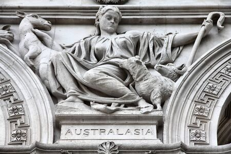 commonwealth: London, United Kingdom - sculpture in facade of Foreign and Commonwealth Office. Allegory of Australasia.