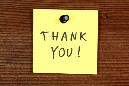 thankfulness: Sticky note with thank you message - thankfulness and gratitude. Bulletin board.