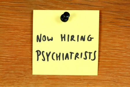 Sticky note with employment opportunity message - hiring psychiatrists. Psychiatry healthcare career. Bulletin board. Stock Photo - 15094798