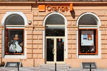 BRASOV, ROMANIA - AUGUST 21: Orange GSM branch on August 21, 2012 in Brasov, Romania. Orange Romania is the largest GSM operator in Romania with 10.274 millions subscribers (2011). Stock Photo - 15102326