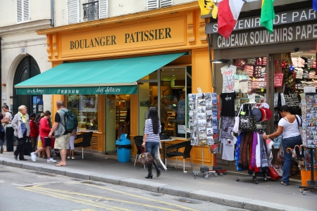 PARIS - JULY 21: Tourists walk past a souvenir store on July 21, 2011 in Paris, France. Paris is the most visited city in the world with 15.6 million international arrivals in 2011. Stock Photo - 15336807