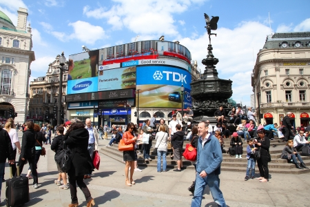 tdk: LONDON - MAY 13: Tourists visit Piccadilly Circus on May 13, 2012 in London. With more than 14 million international arrivals in 2009, London is the most visited city in the world (Euromonitor). Editorial