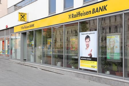 net income: PECS, HUNGARY - AUGUST 11: Reiffeisen Bank branch on August 11, 2012 in Pecs, Hungary. Reiffeisen Group exists since 1927, employs 55,400 people and had 1,2 billion EUR net income in 2011.