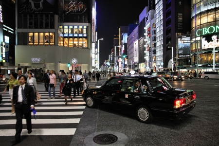 recognized: TOKYO - MAY 8: Evening illumination in Ginza on May 8, 2012 in Tokyo. Ginza is recognized as one of the most luxurious shopping districts in the world, with many flagship luxury brand stores located here.