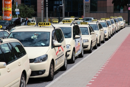 taxicab: DORTMUND, GERMANY - JULY 16: Taxi drivers wait for passengers on July 16, 2012 in Dortmund, Germany. Taxi business is heavily regulated in Germany. Most of cities have typical cream-colored cabs.