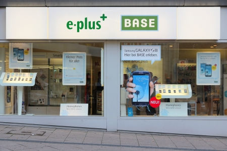 ESSEN, GERMANY - JULY 17: People visit E-Plus store on July 17, 2012 in Essen, Germany. With 19.0 million subscribers, E-Plus is the third largest mobile operator in Germany Stock Photo - 15741022