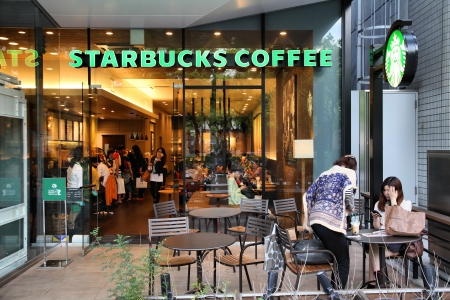 famous industries: NAGOYA, JAPAN - MAY 3: People visit Starbucks Coffee on May 3, 2012 in Nagoya, Japan. Starbucks is the largest coffeehouse company in the world, with 19,435 stores in 58 countries (2012).