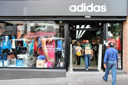 adidas: SANTA CRUZ, SPAIN - OCTOBER 27: Shoppers visit Adidas store on October 27, 2012 in Santa Cruz de Tenerife, Spain. As of 2012, Adidas is the 2nd biggest sportswear manufacturer worldwide.