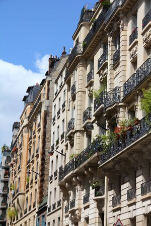 Paris, France - typical old apartment buildings. Windows and balconies. photo