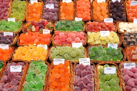 Confectionery shop at Boqueria market in Barcelona, Spain. Colorful gumdrops and wine gum sweets. photo