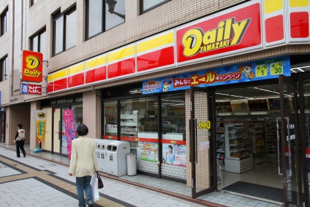 HIROSHIMA, JAPAN - APRIL 21: Customers visit Daily Yamazaki on April 21, 2012 in Hiroshima, Japan. DY is one of largest convenience store franchise chains in Japan with 2048 shops (2012). Stock Photo - 16377606