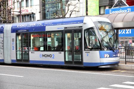 shortest: OKAYAMA, JAPAN - APRIL 22: Customers ride Momo tram on April 22, 2012 in Okayama, Japan. The tram line in Okayama exists since 1910, but is among shortest in Japan (4.7km).